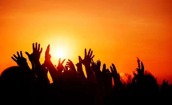 crowd with hands in the air