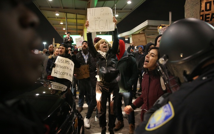 JANUARY 28: Police members intervene and arrest some of activists during the protest against President Donald Trump's 90-days ban of entry on 7 Muslim-majority countries in the Fourth terminal of JFK airport in New York, U.S.A
