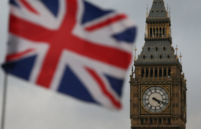 A Union flag flies near Big Ben, and the Houses of Parliament .
