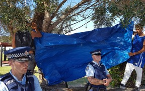 A tarpaulin was put up to block the media's view of Te Tii Marae.