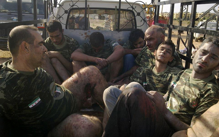 Captured Syrian rebel fighters in 2012. Amnesty International alleges that up to 13,000 Syrians, most of them civilians, were executed by the Syrian government between 2011 and 2015.