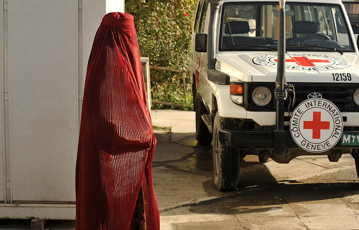 A woman walks past a Red Cross vehicle in Kabul (file photo).