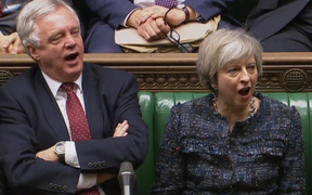 British Prime Minister Theresa May and Brexit Minister David Davis shout 'aye' during the House of Commons vote on the first stage of Brexit legislation.