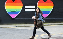 A woman walks past a mural backing same-sex marriage in Ireland on 21 May.