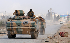 Turkey-backed-opposition fighters advance on the western outskirts of the northern Syrian city of al-Bab.