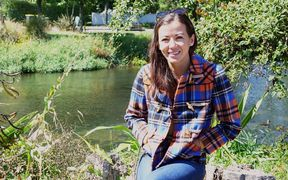 Ecan Councillor and fresh water ecologist, Lan Pham, by the river Avon