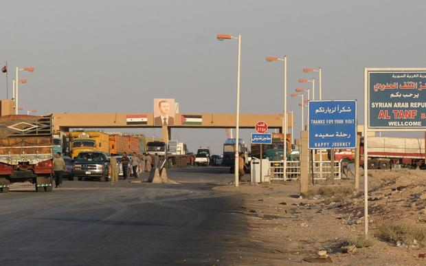 Cars wait in October 2004 at the Syrian-Iraqi border point of al-Tanf, 270km northeast of Damascus.