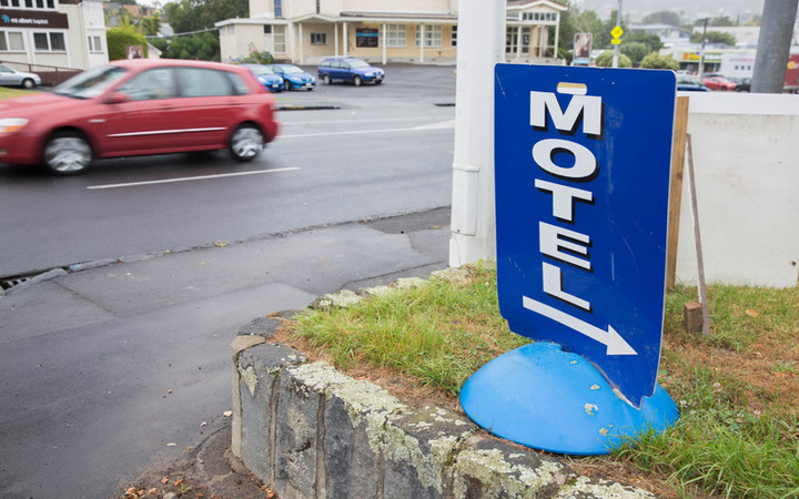 A sign advertising a local motel in Auckland