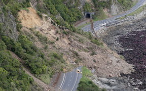 An aerial photo showing earthquake damage to State Highway One near Ohau Point.