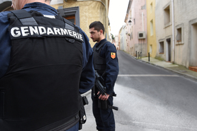Armed police patrol the street in southern Montpellier after four people suspected of planning a terror attack were arrested.