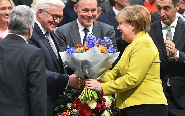 Chancellor Angela Merkel congratulates Germany's newly-elected President, Frank-Walter Steinmeier