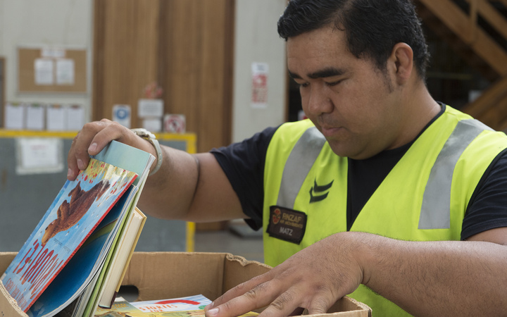 Books being packed by RNZAF for PNG