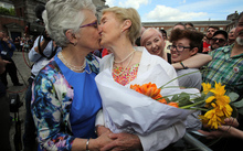 Irish Senator Katherine Zappone (L) kisses her partner Ann Louise Gilligan at Dublin Castle.