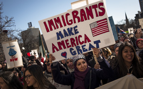 Protestors march in opposition to President Trump's executive order temporarily banning visa holders from seven Muslim-majority countries.