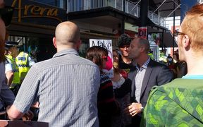 Protestors and an attendee face off in Wellington.