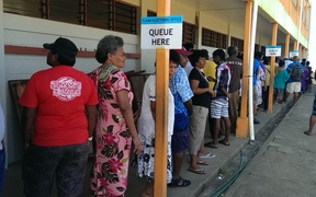 Voters in Fiji's election queue at John Wesley College, Suva.