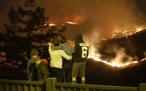 Residents watch the fires burn along Worsley Road and Cracroft, from Dyers Pass Road.