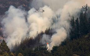 A helicopter battles the fire.