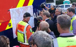 Prime Minister Bill English, centre, and Civil Defence Minister Gerry Brownlee at emergency services headquarters.