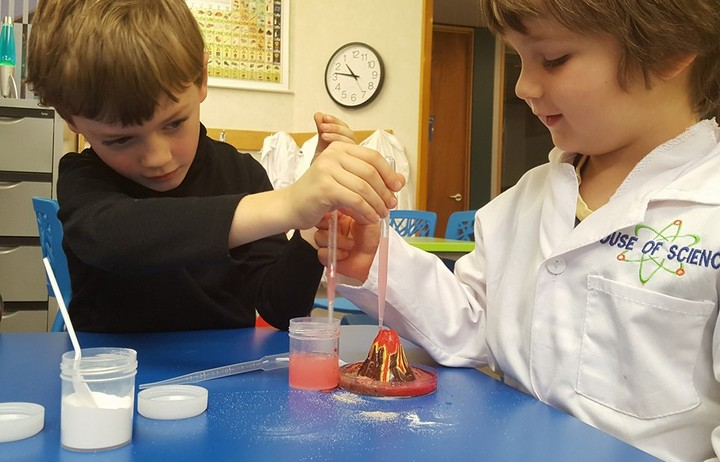 Two children doing a science experiment