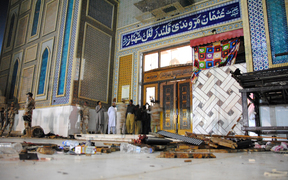 Debris is seen on the ground as Pakistani soldiers cordon off the shrine of 13th century Muslim Sufi Saint Lal Shahbaz Qalandar