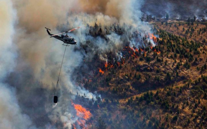 Fourteen helicopters were in the air helping to fight the fire.