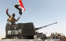 Iraqi security forces and paramilitaries deploy north-west of Baghdad before a major offensive to retake the city of Ramadi from Islamic State.