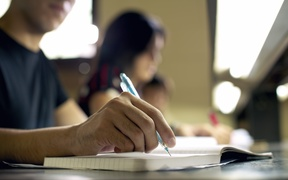 A file photo shows university students studying for an exam
