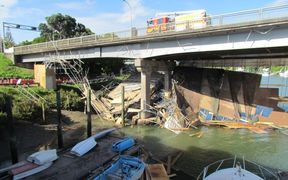 The collapsed scaffolding under the bridge.