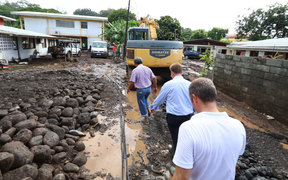 Assessing the damage after severe storms caused flooding across Tahiti.