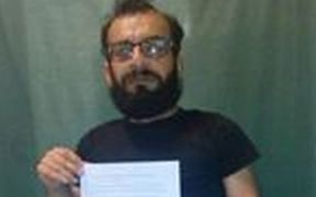 Mehdi Savari holding a letter from detainees to the Australian Human Rights Commissioner.