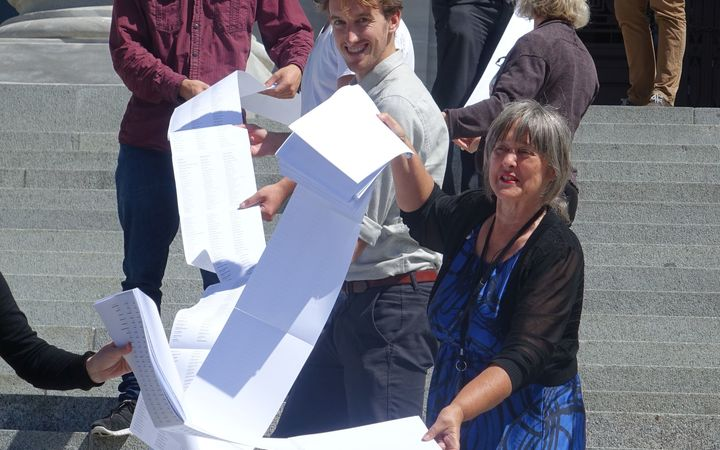 Catherine Delahunty (front) with part of the list of 12,000 names supporting the call for swimmable freshwater.