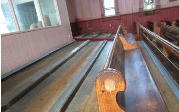The missing pews from the back of the church.