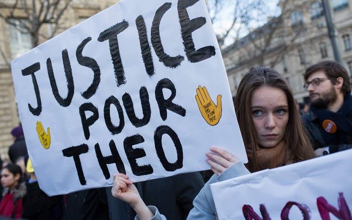 A rally in Paris against police violence when they arrested a young man called Theo in early February.