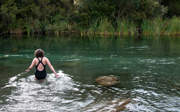 A swimmer in a New Zealand river