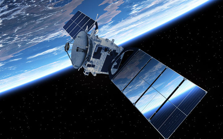 A communication satellite orbiting the earth.