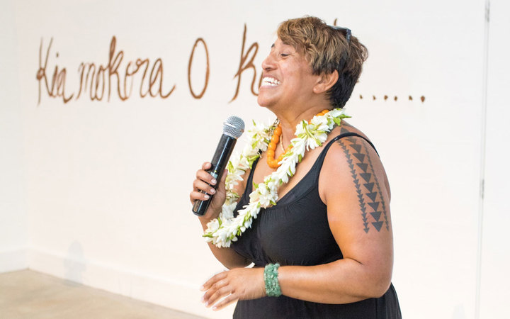 Artist NiaVal Ngaro speaks at the opening of her solo exhibition.