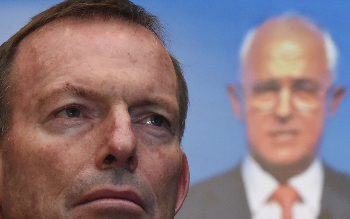 Tony Abbott listens to Australian Prime Minister Malcolm Turnbull address party members at the Coalition Campaign Launch in Sydney on 26 June, 2016.