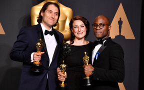 Producers Jeremy Kleiner, left, and Adele Romanski, pose with 'Moonlight' filmmaker Barry Jenkins after their win.