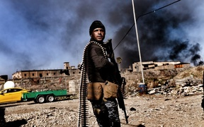 A member of Iraq's elite Rapid Response Division holds position in the northern city of Mosul as they continue the offensive to retake the city's western half from Islamic State (IS).