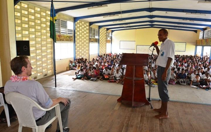 A student of KGVI asks a question to the RAMSI Special Coordinator, Quinton Devlin during the drawdown briefing at the school.