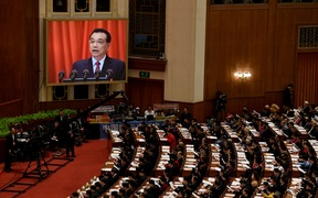 Chinese Premier Li Keqiang is shown on a screen as he delivers his work report during the opening session of the National People's Congress.