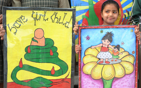Girls participate in a protest against female foeticide, a practice that activists say is still rampant in India.