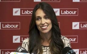 Jacinda Ardern listens to Andrew Little as they speak with media about Little nominating Ardern as Deputy Leader of the Labour Party. Wednesday 01 March 2017