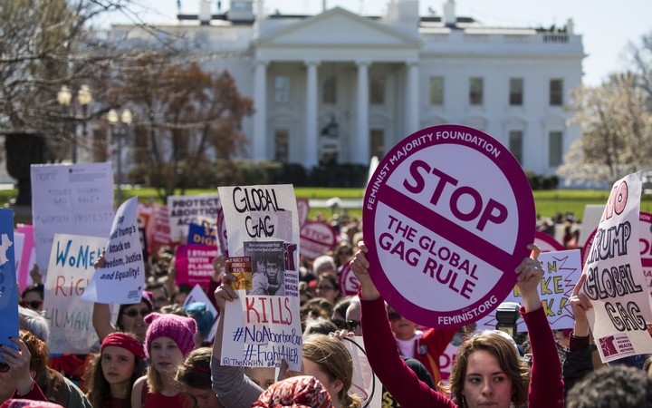 Women gather outside the White House on International Women's Day