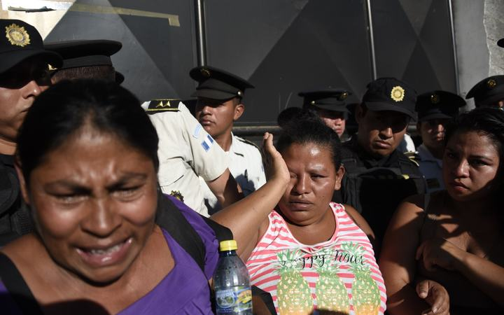 At least 21 dead in Guatemala children's home fire