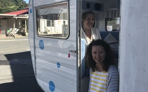 "Houghton Valley principal Raewyn Watson and board chairperson Sarah Graydon with ""Dotty,"" the caravan the school is using for small-group work."