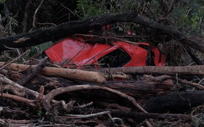 A car was wrecked when it was washed away in the floodwaters in Coromandel.