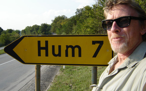 Sound Artist Phil Dadson in tune with a road sign