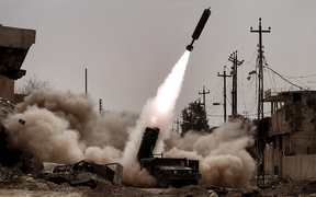 Iraqi troops fire artillery towards Islamic State (IS) jihadists' positions in west Mosul.